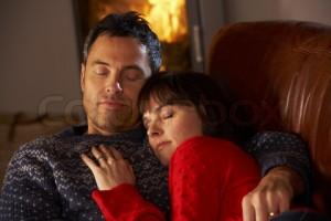cuddling sofa couple