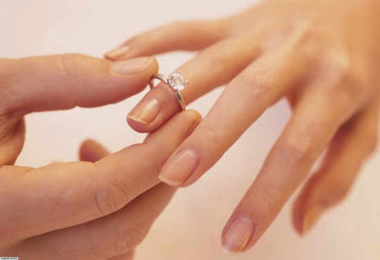 man's hands on wedding