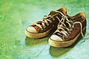 worn shoe soles cause back pain for men
